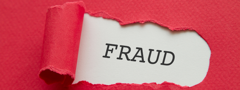 A piece of paper showing the word Fraud