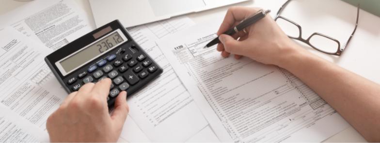 A calculator on a desk as an accountant does the books