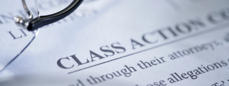A piece of paper with the word Class Action visible at the top. The rest of the words are blurred. Class actions are known as Group Proceedings in Scotland.